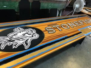 Stonefish Painted Wood Sign In Progress